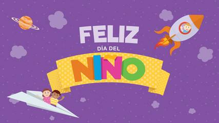 Feliz Dia del Nino greeting card - Happy Children's Day in Spanish language Colored letters on a yellow ribbon with a child flying on a rocket and a couple of children on a paper plane on a purple sky