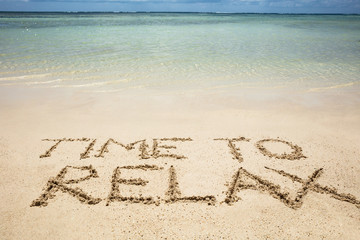 Time To Relax Text On Sand At Beach
