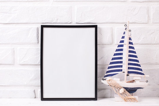 Empty  black frame mockup and  marine decorations