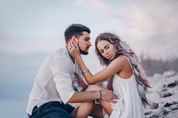 beautiful young couple on the beach at sunset. love and relationships concept