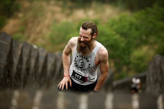 Peter Thorsten Rust of Germany competes in the Great Wall Marathon at the Huangyaguan Great Wall outside Beijing