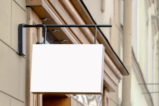 Mock up. Blank rectangular shape signboard on the wall of classical architecture building