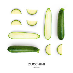 Seamless pattern with green zucchini. Vegetables abstract background. Zucchini on the white background.