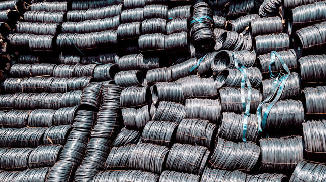 Raw material of steel wire rods import from oversea by bulk shipment, Steel coils in cargo ship, Black carbon wire rode business, Steel roll are loading from ship to truck at port terminal