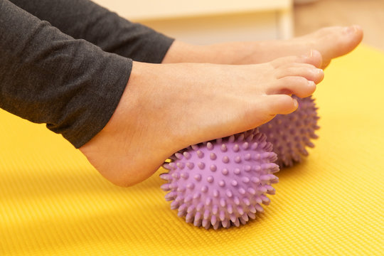 Female feet and prickly massage balls
