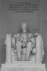 WASHINGTON, DC - AUGUST 06, 2014: The Lincoln Statue, the Lincoln Memorial, white marble, medium shot seated