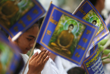 A girl prays during the Vesak Day ceremony at a pagoda on the outskirts of Phnom Penh
