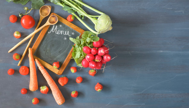 cooking with fresh vegetabels and fruit in the springtime, flat lay with menu blackboard and free copy space