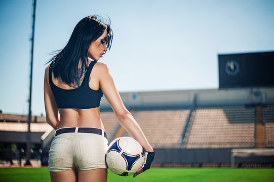 Sexy brunette on the football field