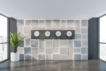 Empty white and gray office hall with clocks