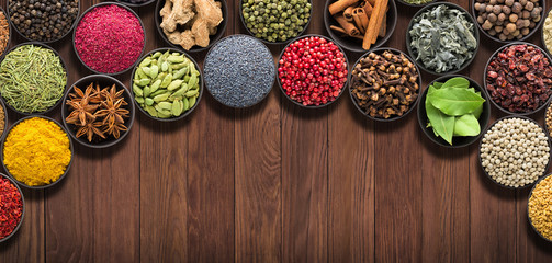 Fototapete - set  European seasonings on  wooden table. Background of spices and herbs for food labels