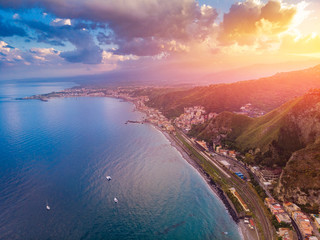 Taormina, Sicily Italy sunset, volcano Etna in clouds. Aerial top view, drone photo Fototapete