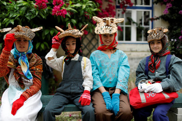 """Members of the """"Entrudo das Aldeias do Xisto"""" folk group pose for a photo before the parade of the 14th International Festival of the Iberian Mask in Lisbon"""