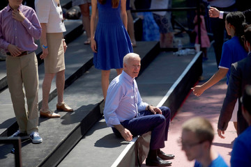 Democratic 2020 U.S. presidential candidate and former Vice President Joe Biden takes a seat before posing with his family for a group portrait after speaking during a campaign rally in Philadelphia
