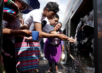 People draw water during a rally to support Bolivia's President Evo Morales in Chimore in the Chapare region