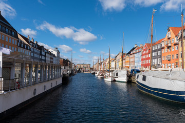 Nyhavn Canal under a blue sky with some clouds