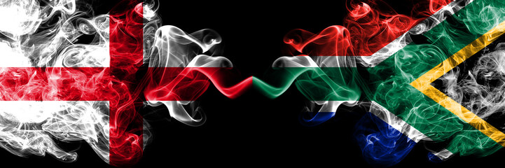 English vs South Africa, African smoky mystic flags placed side by side. Thick colored silky smokes flag of England and South Africa, African.
