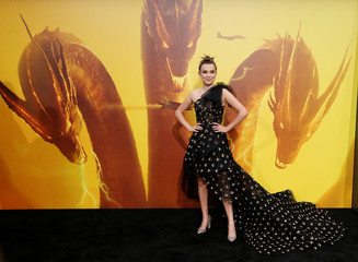"""Cast member Brown poses at a premiere for """"Godzilla: King of the Monsters"""" in Los Angeles"""