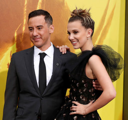 """Director Dougherty and cast member Brown pose at a premiere for """"Godzilla: King of the Monsters"""" in Los Angeles"""