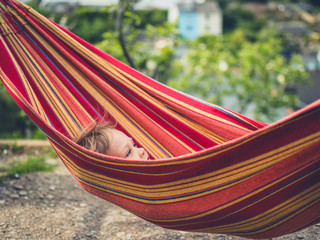 Little toddler relaxing in a hammock