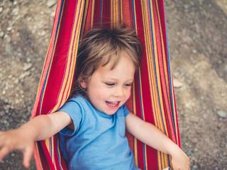 Happy little toddler in a hammock