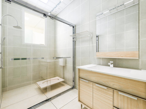 Bathroom and bathroom with glass partition
