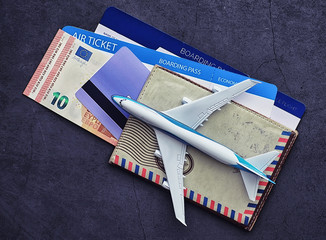 Air ticket and passport for flight plane. Travel concept. Ticket booking.