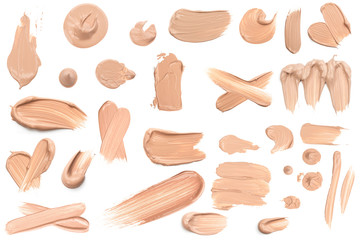 Light beige makeup smear of creamy foundation isolated on white background