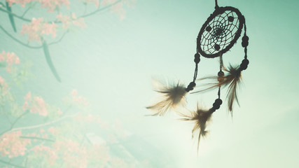 Blurred image, Dream catcher native american in the wind and blurred bright light background, hope and   dream concepts