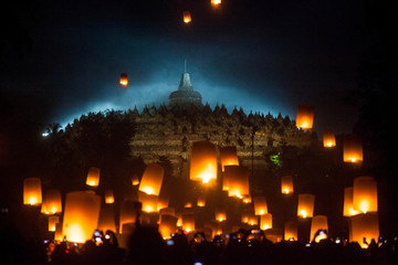 Visitors release paper lanterns during a ceremony on Vesak Day at the Borobudur temple in Magelang, Central Java province