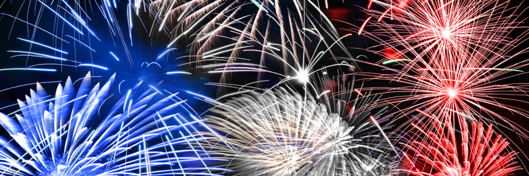 Blue white and red fireworks panoramic background, US or France national party concept
