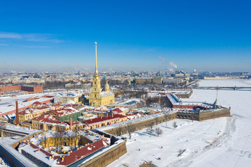 Peter and Paul Cathedral in Saint Petersburg, Russia. It is one of the main landmarks of the city. Golden tall spire of Peter and Paul Cathedral on the blue sky background in winter Wall mural