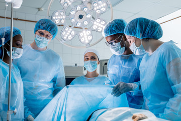 cheerful team of studentspassing exams in operating room at the hospital.close up photo, good job