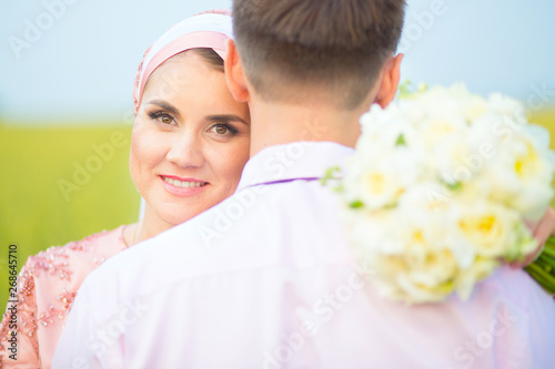 National wedding  Bride and groom in field  Wedding muslim couple