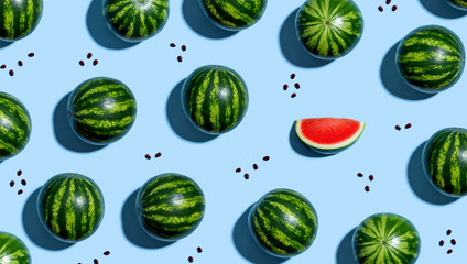 Wall Mural - One out unique watermelons arranged on a blue background