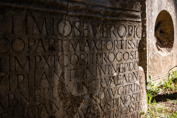 Stone inscription in ancient Roman ruin in Cuicul, Djemila, Algeria