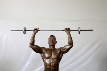 Bodybuilder prepares backstage during the16th Southeast Asia Bodybuilding and Physique Sports Championships in Yangon