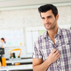 Closeup of casual young man at office