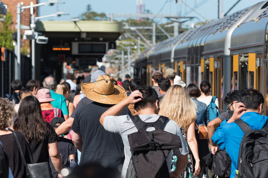 Train station with crowd of unrecognizable people