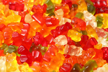 Many delicious colorful jelly bears as background, closeup
