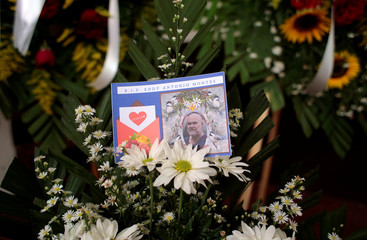 A portrait of U.S. citizen Eddy Montes, who was killed in a prison shooting, is seen on a wreath as the coffin with his body is displayed at the Mologuina church in Matagalpa