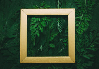 Creative layout made of forest (field) grass with gold wooden frame.  Modern ecological natural concept