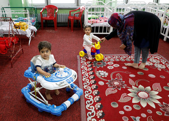 Afghan children play at a day care center at the Ministry of Communications and IT in Kabul