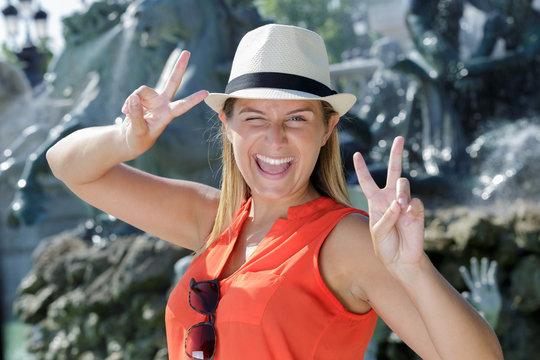 young female tourist doing a wacky pose