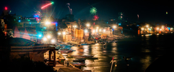 Beautiful night panorama skyline view of the ghats and Ganges River in Varanasi, India on Divali