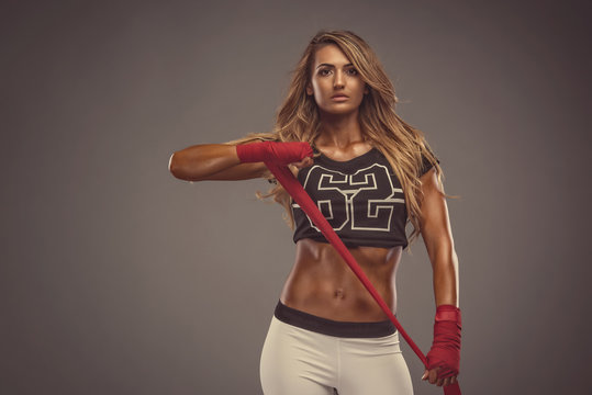 MMA Girl. Beautiful Fit Woman Wrapping her Hands in Boxing Bandages