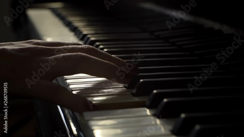 Woman pianist plays gentle classical music on a beautiful grand