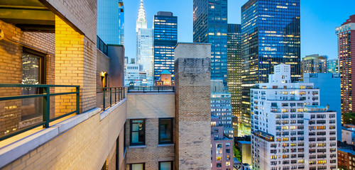 Wall Mural - Tall skyscrapers of Midtown Manhattan, night aerial view