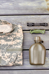 Military accessories arrangement flat lay. Top view. Wooden background.
