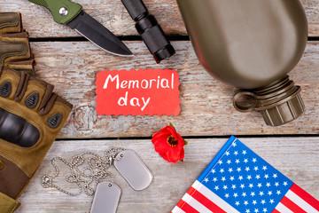 Memorial day, veteran's souvenirs, top view. Wooden desk background.